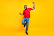 Full length body size photo of rejoicing glad cheerful happy black man dancing with joy while isolated with yellow background