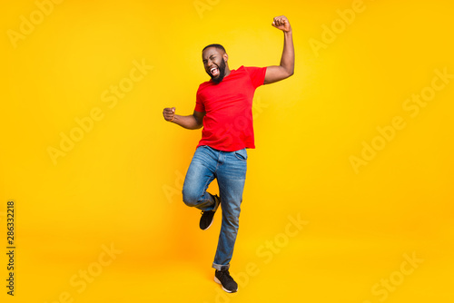 Full length body size photo of rejoicing glad cheerful happy black man dancing w Tableau sur Toile