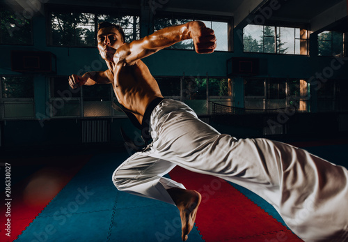 Kickbox fighter training in the gym with the punch bag Canvas Print