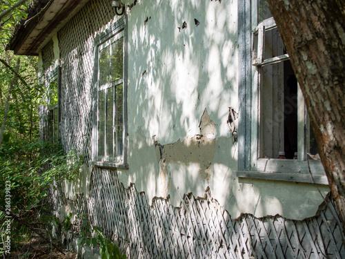 Photo Abandoned rural house in Zalissya village in Chernobyl Exclusion Zone, Ukraine