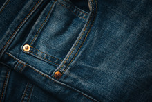 Blue Denim Jeans Pocket Design Details With Rivets And Seams Close Up View
