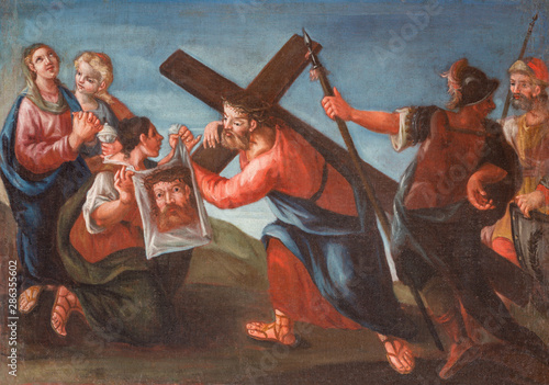 MALCESINE, ITALY - JUNE 13, 2019: The painting of Veronica wipes the face of Jesus (part ot Via Crucis) in church Chiesa di Santo Stefano by unknown artist of 17. cent.