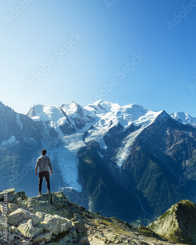 Man posing in front of Montblanc in the French Alps in Chamonix during a summer holiday trip Wallpaper Mural