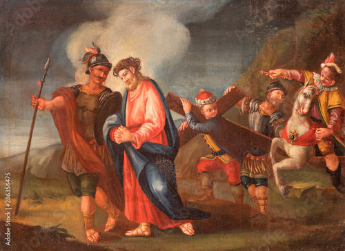 MALCESINE, ITALY - JUNE 13, 2019: The painting of Simon of Cyrene helps Jesus carry the cross (part ot Via Crucis) in church Chiesa di Santo Stefano by unknown artist of 17. cent.