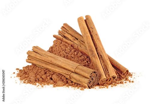 Fototapeta Ceylon cinnamon sticks with powder on a white background obraz