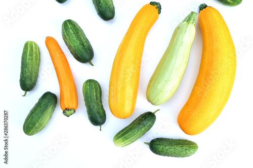 Photo Fresh harvested yellow zucchini squash and green cucumbers