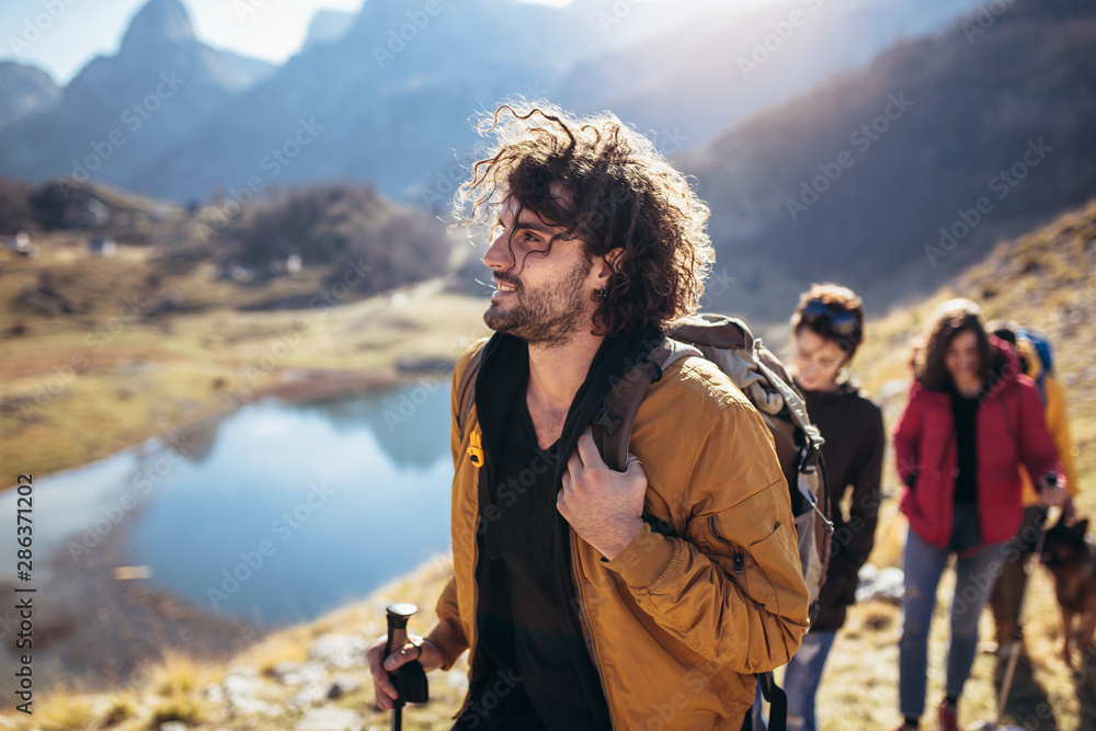 Fototapety, obrazy: Group of hikers walking on a mountain at autumn day