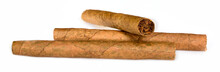 Three Tobacco Cigarillos Isolated On White Background. Macro Close Up, High Resolution.