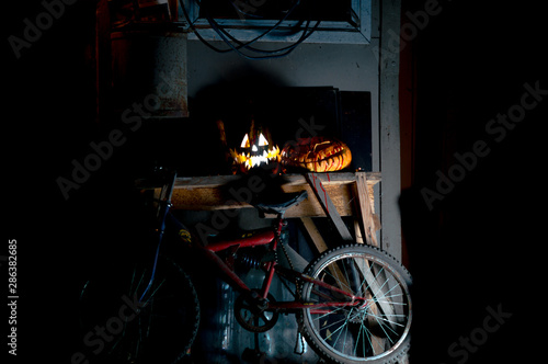 Tuinposter Fiets halloween october holiday orange pumpkin and candles