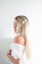 Blonde Hair Girl With White Pe...