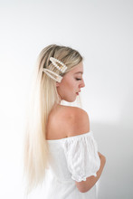 Blonde Hair Girl With White Pearl Hair Clips In Hair, White Background