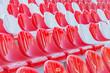Leinwanddruck Bild - Red abd white empty seats on the tribune of the new stadium.