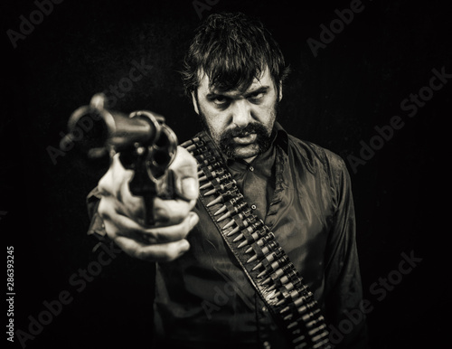Fotomural  Old west cowboy outlaw with a bandolier of bullets and a revolver pistol handgun