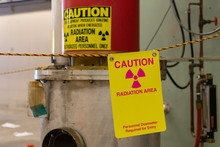 Ionizing Radiation Hazard Symbol, Caution Radiation Area And Personnel Dosimeter Required Text On Yellow Warning Sign Displayed On The Equipment That Produces Ionizing Radiation