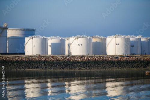 Fotomural Fuel and oil storage tanks along the water at the port of Le Havre