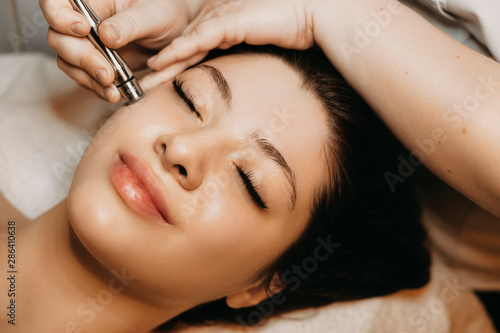 close-up-of-a-lovely-caucasian-woman-having-microdermabrasion-non-invasive-therapy-with-derma-pen-in-a-wellness-center