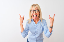 Middle Age Businesswoman Wearing Elegant Shirt And Glasses Over Isolated White Background Shouting With Crazy Expression Doing Rock Symbol With Hands Up. Music Star. Heavy Music Concept.