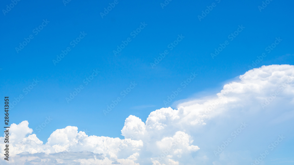 Fototapety, obrazy: Beautiful blue sky and white cumulus clouds abstract background. Cloudscape background. Blue sky and fluffy white clouds on sunny day. Nature weather. Bright day sky for happy day background.