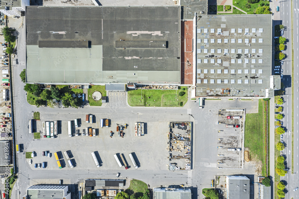 Fototapety, obrazy: aerial top view of modern industrial building and warehouse with parked trucks and cars. drone photo