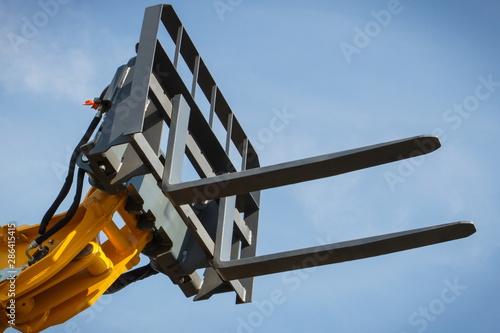 Valokuva Part of forklift loader or stacker on blue sky background