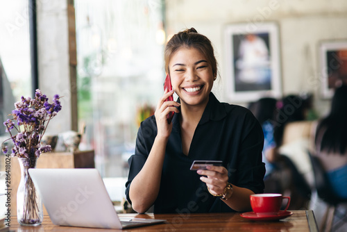 Asian woman call to bank call center for card problem - 286418024