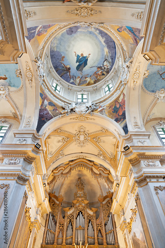 CATANIA, ITALY - APRIL 6, 2018: The fresco of Assumption of Virgin Mary and four Evangelists in cupola of church Basilica Maria Santissima dell'Elemosina by Giuseppe Sciuti (1896).