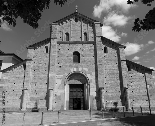COMO, ITALY - MAY 9, 2015: The facede of romanesque church Basilica di San Abbondio.