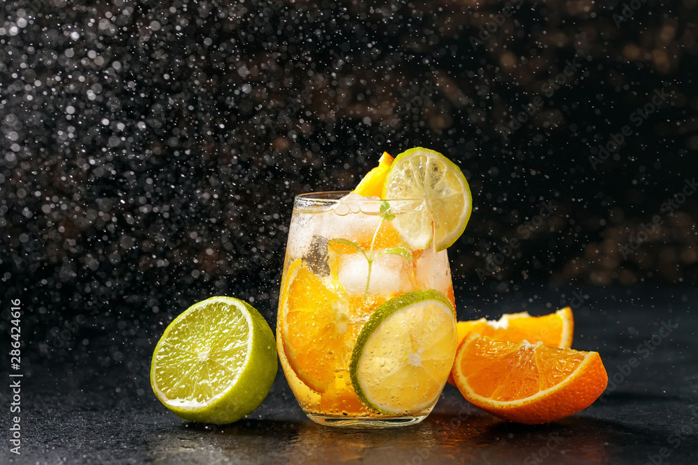 Fototapety, obrazy: Cocktail with orange, lime and ice