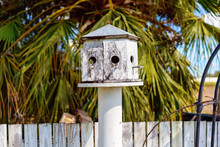 A White Bird House In A Garden