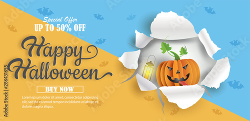 Fényképezés  Paper art style of pumpkin breaking through paper, Halloween sale promotion banner with discount offer on special occasion, give voucher, banner, poster or background