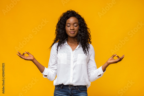 Obraz Young beautiful black girl practicing breathing yoga - fototapety do salonu