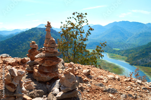 Poster de jardin Zen pierres a sable pyramid of mountain stones on the edge above the river valley