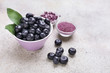 Leinwanddruck Bild - Acai berries with powder and tablets on light background