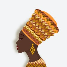 African Woman In Turban And Ea...