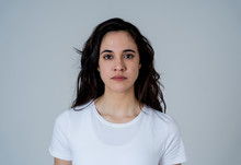 Portrait Of Beautiful Young Latin Woman With Angry And Furious Face. Human Expressions And Emotions