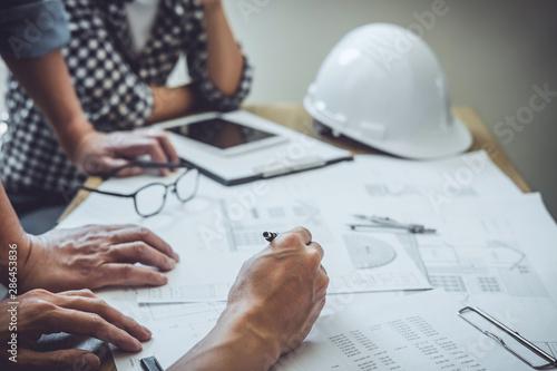 Fototapeta  Engineer Teamwork Meeting, Drawing working on blueprint meeting for project work