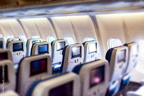 Fotografía  Modern aircraft interior with seats and blank touch entertainment screens displays