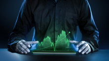 Business Man Showing Profitable Stock Market Holographic Technology Graphs In Modern Work Background For The Future. Company Managers In Concept Planning And Managing Global Marketing And Investment.
