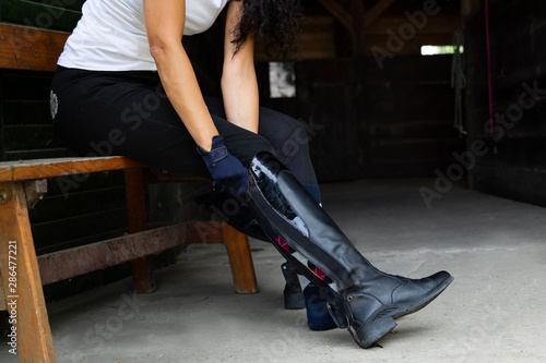 Tableau sur Toile Equestrian sport. Leather equestrian boots. Riding clothes.