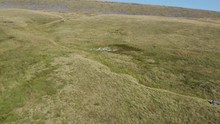 Aerial Drone Flying Over The Old Wreckage Of An Aeroplane On A Remote Hillside