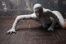 Scary Mummy Creeps On You. The Girl With The Bandage Crawling On The Floor