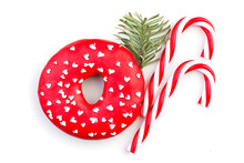 Christmas Decorations, Red Lollipop And Green Fir Branch On White Background