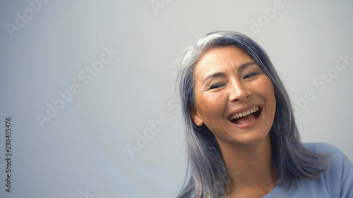 Cuadros en Lienzo Beautiful Asian Woman Is Laughing With A Cunning Face
