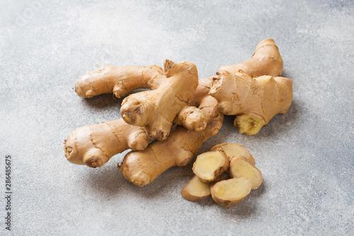 Fototapeta Fresh ginger root on grey background. Copy space. obraz
