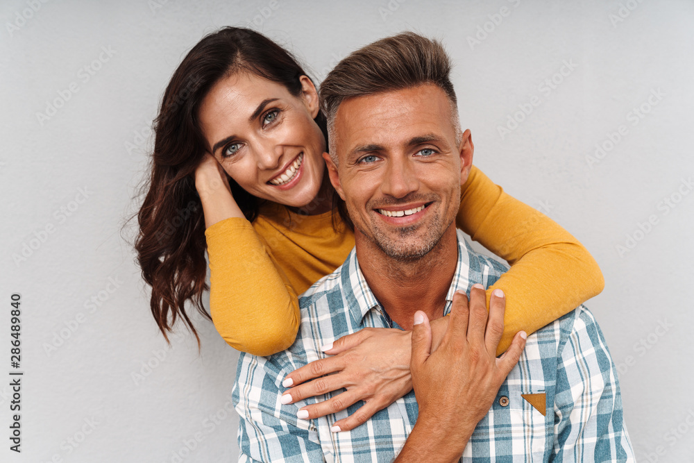 Fototapety, obrazy: Cheerful optimistic adult loving couple isolated over grey wall background.