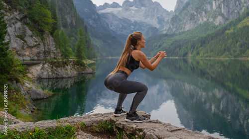 Foto op Canvas Ontspanning Young sexy athletic girl in the mountains near the lake