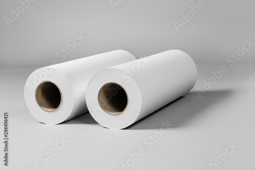 Blank White Paper Rolls Isolated On Gray Background Mockup
