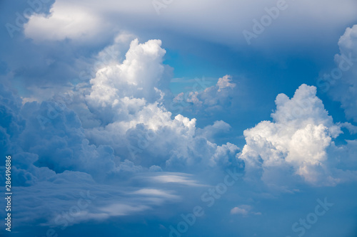 Obraz The blue sky and white clouds at an altitude of 10,000 meters under the sun - fototapety do salonu