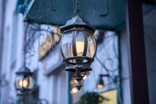 Beautiful Wrought Iron Lanterns At The Entrance To The House In The Evening.