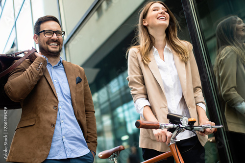 Photo sur Toile Les Textures Office woman with business man couple enjoying break while talking flirting outdoor